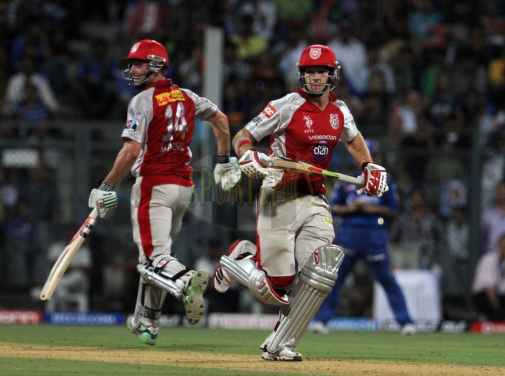 Kings XI Punjab player David Miller and Kings XI Punjab player Shaun Marsh takes a run during match 28 of the Indian Premier League ( IPL) 2012  between The Mumbai Indians and the Kings X1 Punjab held at the Wankhede Stadium in Mumbai on the 22nd April 2012..Photo by: Vipin Pawar/IPL/SPORTZPICS