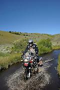 Ride leader Jim Hyde crossing a low water stream near Morrison Lake in the Montana Rockies.