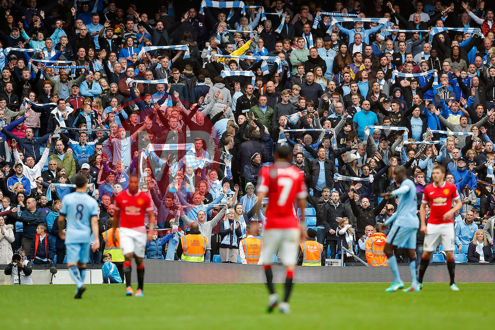 Manchester City fans celebrates at the whistle as their side win 1-0 - Photo mandatory by-line: Rogan Thomson/JMP - 07966 386802 - 02/11/2014 - SPORT - FOOTBALL - Manchester, England - Etihad Stadium - Manchester City v Manchester United - Barclays Premier League.