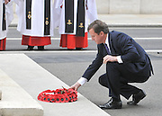 David Cameron Prime Minister lays a wreath on behalf of the nation, commemorating the war dead. The Prime Minister, HRH Prince Charles and Duchess of Cornwall attend the 65th Anniversary of Japan's WWII surrender.