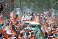 Varanasi, Uttar Pradesh, India. 24th April, 2014. Several thousand BJP supporters lined the streets of Varanasi to greet NARENDRA MODI as he visited the Uttar Pradesh city to file his nomination papers for the Lok Sabha elections. // Lee Thomas, Flat 47a Park East Building, Bow Quarter, 60 Fairfield Road, LONDON, E3 2UT. Tel. 077 8414 2973. Email: leepthomas@gmail.com  www.leept.co.uk