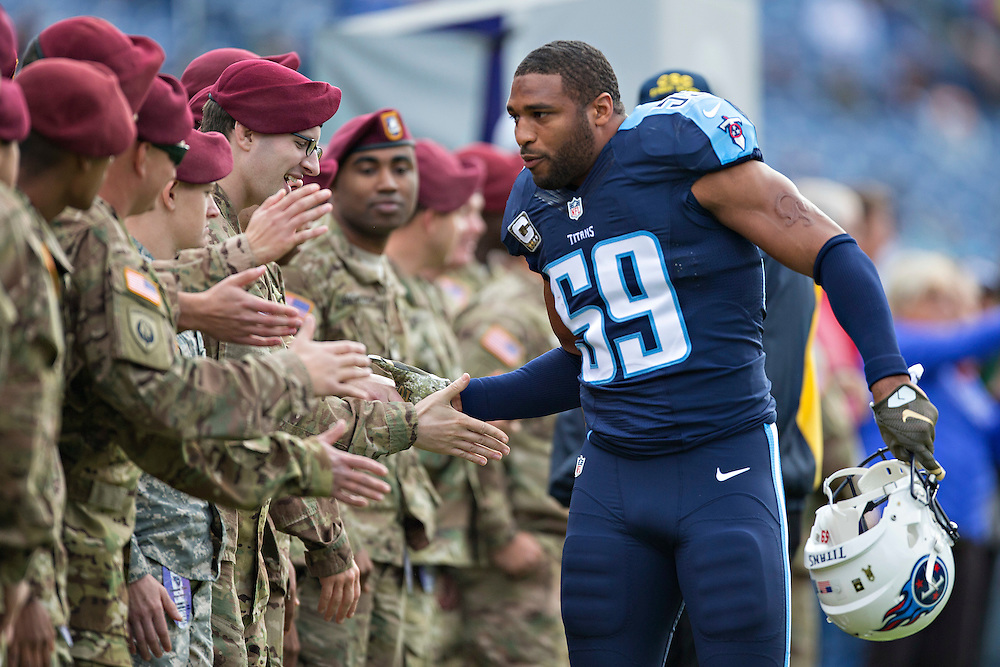 NASHVILLE, TN - NOVEMBER 15:  Wesley Woodyard #59 of the Tennessee Titans shakes hands with visiting soldiers before a game against the Carolina Panthers at Nissan Stadium on November 15, 2015 in Nashville, Tennessee.  (Photo by Wesley Hitt/Getty Images) *** Local Caption *** Wesley Woodyard