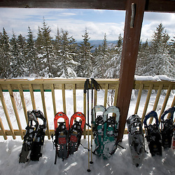 Snowshoes on the front porch of the Appalachian Mountain Club's Hi-Cabin on Mount Cardigan in Canaan, NH.  Hurricane Gap Trail.