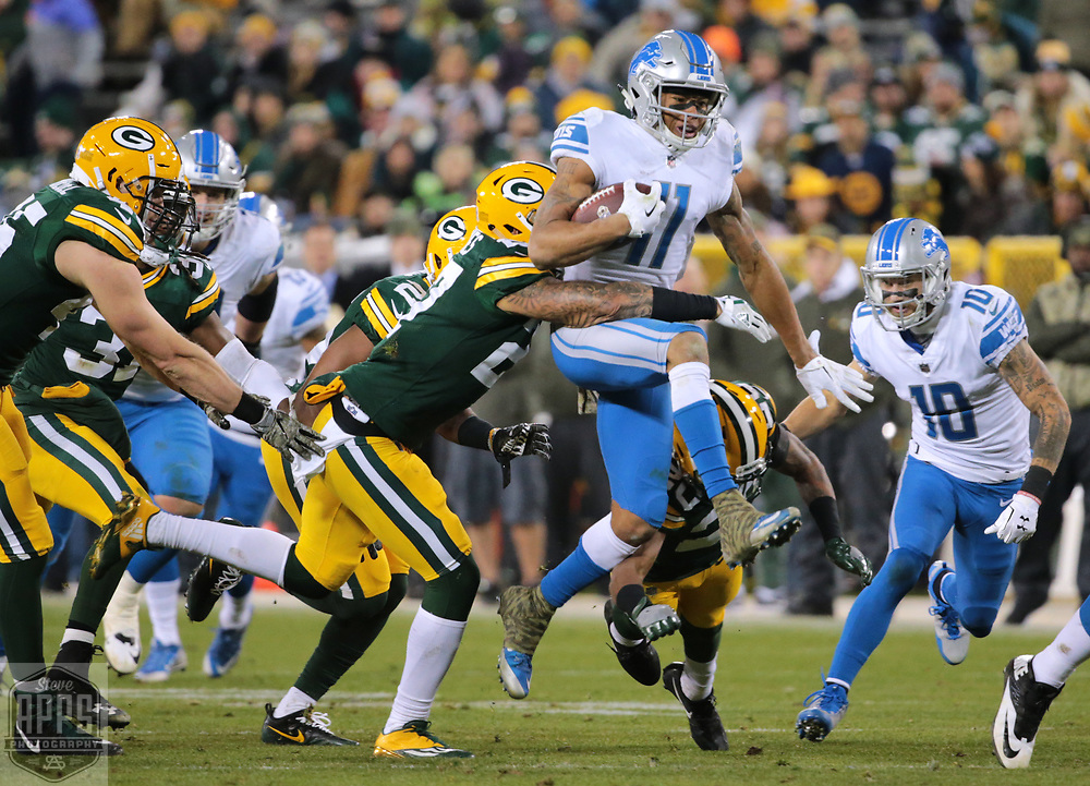 Green Bay Packers safety Josh Jones (27) tackles Detroit Lions wide receiver Marvin Jones (11) after a 4th quarter reception. <br /> The Green Bay Packers hosted the Detroit Lions at Lambeau Field Monday, Nov. 6, 2017. STEVE APPS FOR THE STATE JOURNAL.