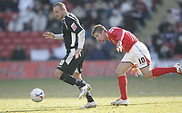 Photo: Aidan Ellis.<br /> Barnsley v Swansea City. Coca Cola League 1. 04/03/2006.<br /> Swansea's Lee trundle is chased by Barnsley's Stephen Mcphail