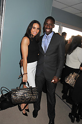 Athletes LOUISE HAZEL and DWAIN CHAMBERS at the 2012 Hennessy Gold Cup at Newbury Racecourse, Berkshire on 1st December 2012
