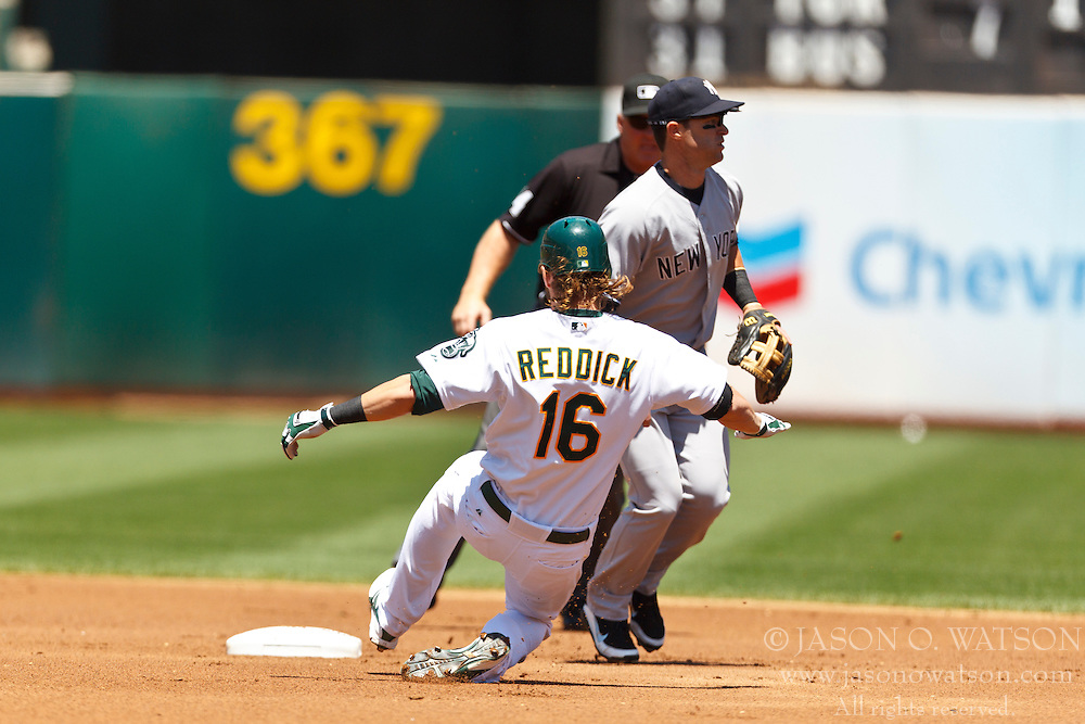 OAKLAND, CA - JULY 22: Josh Reddick #16 of the Oakland Athletics slides into second base after hitting a double against the New York Yankees during the first inning at O.co Coliseum on July 22, 2012 in Oakland, California.  (Photo by Jason O. Watson/Getty Images) *** Local Caption *** Josh Reddick
