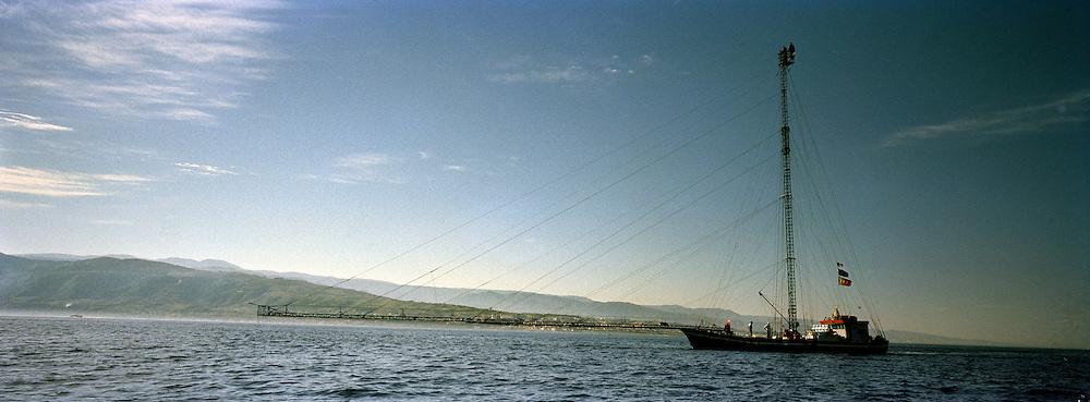 Feluca, barca di pescatori per la caccia al pesce spada. l'alterna che si vede è alta 35-40 metri. La passerella anche più di 70 metri. Feluca. Tipic sicilian fishing boat about hunting swordfish. Antenna high more than 40 meters. The fisherman can see the fish up to 3 km.