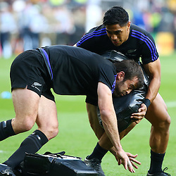 LONDON, ENGLAND - OCTOBER 31: Malakai Fekitoa  holds a tackle bag for Conrad Smith of New Zealand during the Rugby World Cup Final match between New Zealand vs Australia Final, Twickenham, London on October 31, 2015 in London, England. (Photo by Steve Haag)
