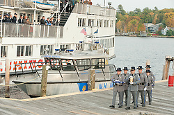 Members of NH Marine Patrol carry the remains of Director David T. Barrett to the MS Mount Washington for a memorial service on Monday, October 23, 2011.  (Alan MacRae/for the Laconia Daily Sun)