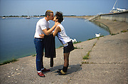 Gavin and Kelly Kissing by the Water, Colnbrook Reservoir, High Wycombe, UK, 1980s.
