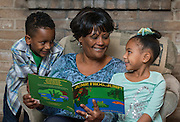 Odella Colbert reads with her grandchildren Donovan and Devin, January 22, 2015.