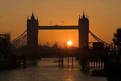 © Licensed to London News Pictures. 10/10/2018. London, UK.  Sunrise behind Tower Bridge on the River Thames during warm and sunny weather this morning.  Photo credit: Vickie Flores/LNP
