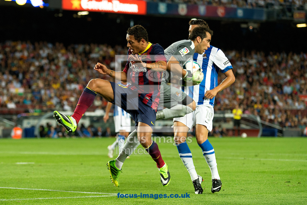 Picture by Cristian Trujillo/Focus Images Ltd +34 64958 5571<br /> 24/09/2013<br /> Adriano Correia of FC Barcelona and Claudio Bravo of Real Sociedad during the La Liga match at Camp Nou, Barcelona.