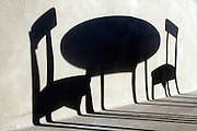 shadow of a round table with two chairs