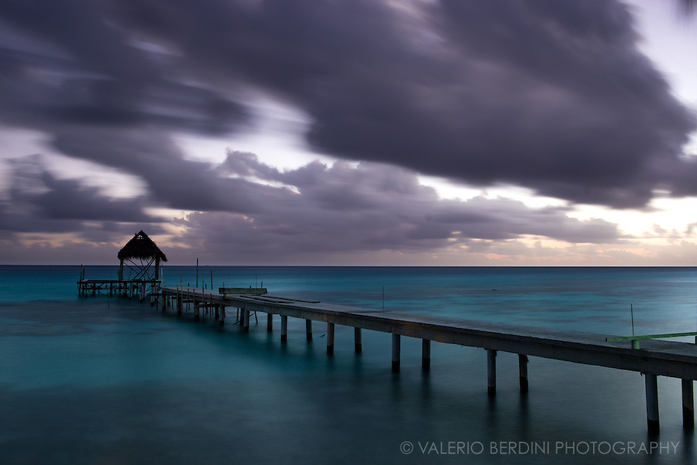 A pier seen at night over the lagoon of Fakarava atoll.