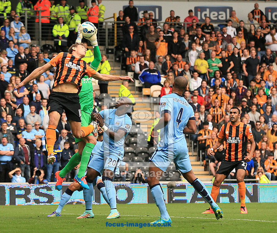 Nikica Jelavic (left) of Hull City challenges Wilfredo Caballero of Manchester City for the high ball during the Barclays Premier League match at KC Stadium, Hull<br /> Picture by Richard Gould/Focus Images Ltd +44 7855 403186<br /> 27/09/2014