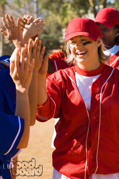 Softball Teams Congratulating Each Other