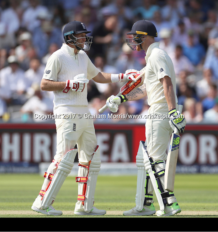 Captain Joe Root (left) congratulates Ben Stokes on his ('second') half-century (after a scoreboard error) during the 1st Investec Test Match between England and South Africa at Lord's Cricket Ground. Photo: Graham Morris/www.cricketpix.com / www.photosport.nz
