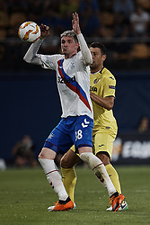 September 20, 2018 - Vila-Real, Castellon, Spain - Kyle Lafferty (L) of Rangers competes for the ball with Daniele Bonera of Villarreal CF during the UEFA Europa League group G match between Villarreal CF and Rangers at Estadio de la Ceramica on September 20, 2018 in Vila-real, Spain  (Credit Image: © David Aliaga/NurPhoto/ZUMA Press)