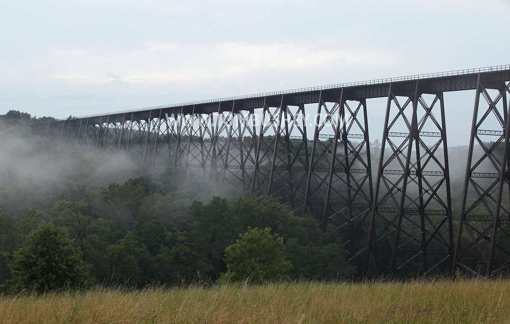 Salisbury Mills, New York - Fog moves under the Moodna Viaduct railroad trestle on July 21, 2010.