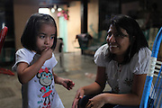 Local leader Yolanda Oqueli speaks with her two-year old daughter Jimena at home. Yoli Oqueli suffered a murder attempt on June 13, 2012, due to her involvement with the anti-mining movement. The bullet is still lodged in her back. Since March 2nd, 2012, local neighbors from San José del Golfo and San Pedro Ayampuc have blocked the entrance to the EXMINGUA gold mine - owned by Kappes, Cassiday & Assocaites (KCA) based in Reno, Nevada, USA. Residents from the communities claim the industrial activity in their territories as illegal since they were not appropriately consulted before the mine began operating. La Puya, San Pedro Ayampuc, Guatemala. May 14, 2013.