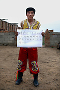 Li Jung Yang - 25 Yrs.<br /> Was a Mongolian sheep herder but due to a ban on keeping lifestock in the area is now a tourist guide.<br /> Inner Mongolia.<br /> <br /> 'I hope I could eat lamb, quaff wine spirits, and keep singing and dancing like I was five years ago. This is our families wish'.