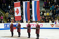KELOWNA, BC - OCTOBER 26: Pairs flags rise during medal ceremonies of Skate Canada International held at Prospera Place on October 26, 2019 in Kelowna, Canada. (Photo by Marissa Baecker/Shoot the Breeze)