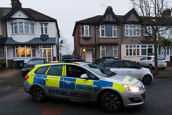 © Licensed to London News Pictures. 23/01/2020. London, UK. Police and a car with police tape in Waverley Avenue, Chingford, where a woman aged in her 60's was found by police last night suffering from head injuries and was pronounced dead at the scene. Officers were called at 2335hrs on Wednesday, 22 January, to a report of a disturbance at an address in Waverley Avenue, E4. A man, aged in his 20s, was arrested at the location and taken into custody at a north London police station. Enquiries are underway to establish the full circumstances. Officers believe the deceased and the man arrested were known to each other. Photo credit: Vickie Flores/LNP