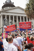 "Evangelical Christians wave signs and bibles during the ""Stand With God"" rally  August 29, 2015 in Columbia, SC. Thousands of conservative Christians gathered at the State House to rally against gay marriage and listen to GOP presidential candidates Gov. Rick Perry and Sen. Ted Cruz speak."