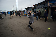 A group of Pakistani migants are seen palying cricket in the Calais refugees camp also known as the Jungle. Calais, France. FEDERICO SCOPPA/CAPTA