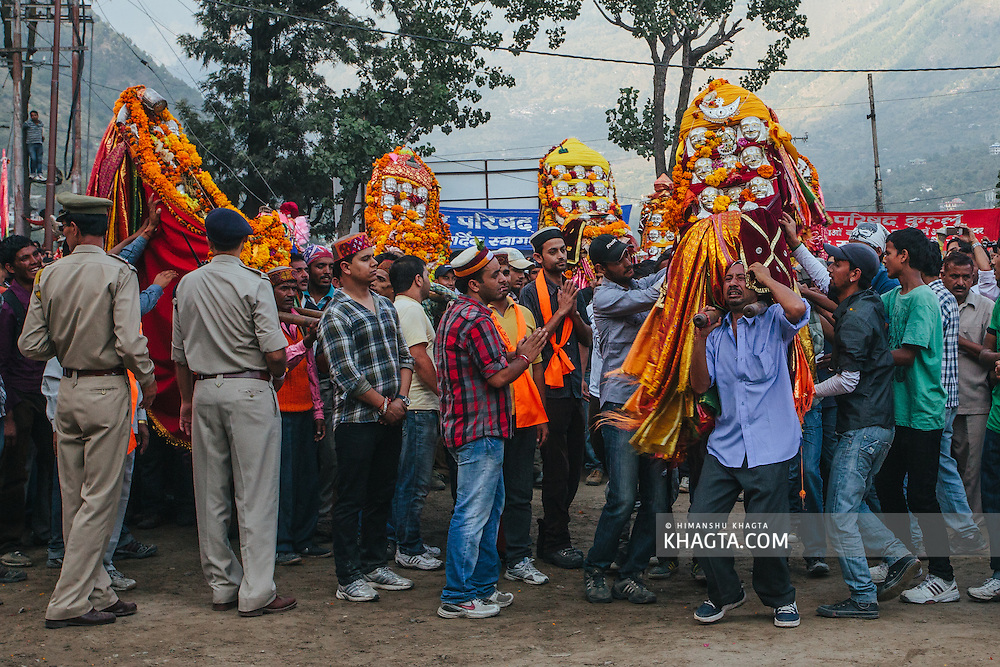 A man struggles with the palinquin of the deity at Dhalpur ground, Kullu. Kullu Dussehra is the Dussehra festival observed in the month of October in Himachal Pradesh state in northern India. It is celebrated in the Dhalpur maidan in the Kullu valley. Dussehra at Kullu commences on the tenth day of the rising moon, i.e. on 'Vijay Dashmi' day itself and continues for seven days. Its history dates back to the 17th century when local King Jagat Singh installed an idol of Raghunath on his throne as a mark of penance. After this, god Raghunath was declared as the ruling deity of the Valley.