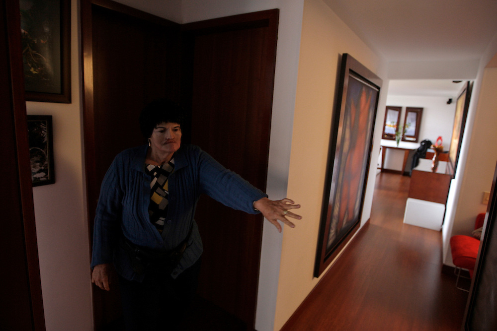 Rarely left alone, Amalia Mendoza struggles to find her way around her daughter's apartment in Colombia. Despite looking more like her former self, Mendoza still cannot see. Greg Kahn/Staff