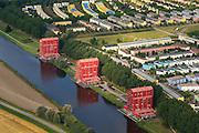 Nederland, Flevoland, Almere, 27-08-2013; Almere-Buiten, Regenboogbuurt met aan het water van de Lage Vaart de Rooie Donders van architect Liesbeth van der Pol.<br /> Residential distict Regenbouwbuurt (Rainbow Area). Next to the canal Lage Vaart some red buildings called Rooie Donders (red devils) by architect Liesbeth van der Pol.<br /> luchtfoto (toeslag op standaard tarieven);<br /> aerial photo (additional fee required);<br /> copyright foto/photo Siebe Swart.
