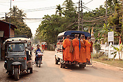 """Mar. 11, 2009 -- VIENTIANE, LAOS: Buddhist monks ride on a """"songthaew"""" in Vientiane, Laos. Songthaew literally means two seats but has been adopted to mean a pickup truck converted to carry passengers by adding two benches to the bed of the pickup. Songthaews are commonly used as buses in rural Thailand and Laos.   Photo by Jack Kurtz / ZUMA Press"""