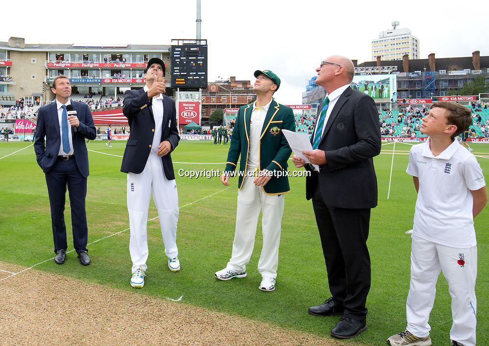 Alastair Cook of England tosses the coin, Michael Clarke of Australia looks on. England v Australia, 5th and final Ashes Test, Day 2, Oval, London. 20/08/2015 © Matthew Impey/www.cricketpix.com