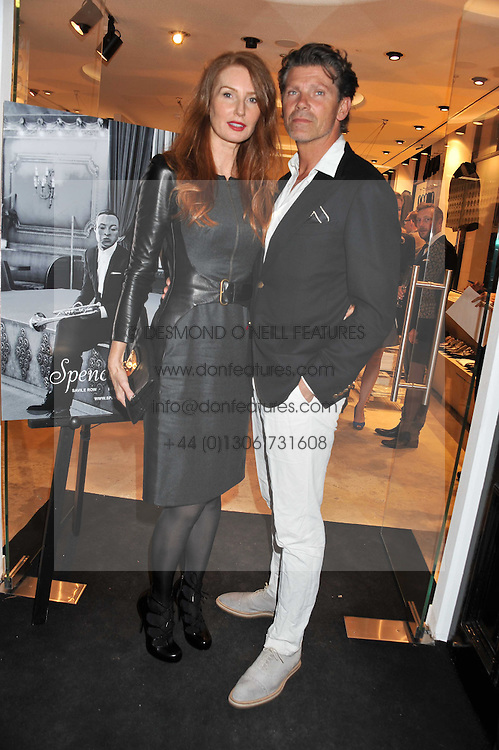 COLIN & ANGELA RADCLIFF at the launch of the Spencer Hart Flagship store, Brook Steet, London on 13th September 2011.