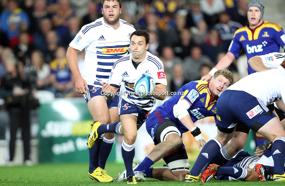 Dewaldt Duvenage clears the ball from a ruck.<br /> Investec Super Rugby - Highlanders v Stormers, 7 April 2012, Forsyth Barr Stadium, Dunedin, New Zealand.<br /> Photo: Rob Jefferies / photosport.co.nz