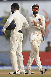 July 29, 2017 - Galle, Sri Lanka - Indian cricket captain Virat Kohli(R) walks off with a stump in his hands after India defeated Sri Lanka by 304 runs during the 4th Day's play in the 1st Test match between Sri Lanka and India at the Galle cricket stadium, Galle, Sri Lanka on Saturday 29 July 2017. (Credit Image: © Tharaka Basnayaka/NurPhoto via ZUMA Press)