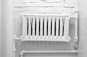 same color white hot water type radiator wall and room
