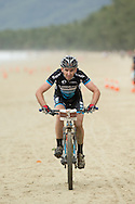 Competitors ride into the finish, June 1, 2014 - MOUNTAIN BIKE : RRR Mountain Bike Challenge, Cairns Airport Adventure Festival, Four Mile Beach, Port Douglas, Queensland, Australia. Credit: Lucas Wroe
