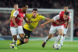 23.11.2011, Emirates Stadion, London, ENG, UEFA CL, Gruppe F, FC Arsenal (ENG) vs Borussia Dortmund (GER), im Bild Arsenal's Aaron Ramsey and Theo Walcott in action against Borussia Dortmund's Sebasian Kehl during the football match of UEFA Champions league, group F, between FC Arsenal (ENG) and Borussia Dortmund (POR) at Emirates Stadium, London, United Kingdom on 2011/11/23. EXPA Pictures © 2011, PhotoCredit: EXPA/ Sportida/ Chris Brunskill..***** ATTENTION - OUT OF ENG, GBR, UK *****