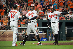 July 19, 2017 - Baltimore, MD, USA - The Baltimore Orioles' Manny Machado (13) celebrates with teammates Jonathan Schoop (6) and Adam Jones (10) after a three-run triple by teammate Trey Mancini in the seventh inning at Oriole Park at Camden Yards in Baltimore on Wednesday, July 19, 2017. The Orioles won, 10-2. (Credit Image: © Michael Ares/TNS via ZUMA Wire)