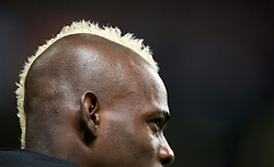 MANCHESTER, ENGLAND - Monday, April 30, 2012: Manchester City's Mario Balotelli shows off his new hair style, a Mohican dyed yellow, as he warms-up as an unused substitute during the Premiership match against Manchester United at the City of Manchester Stadium. (Pic by David Rawcliffe/Propaganda)