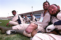 Disable athlete takes is prosthesis off after playing football at Ghazi Stadiun, Kabul..On 23-25 August 2005, Special Olympics Afghanistan held its first national Games at Olympic Stadium in Kabul. More than 300 athletes, including 80 female athletes, experienced a taste of happiness and achievement for the first time in their lives. They competed in athletics, bocce and football (soccer). Because of cultural restrictions, males and females competed at separate venues.