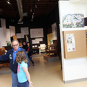 "Terry Williams, who grew up in Salem, shows an exhibit to his granddaughter, Madilyn. The Oregon State Hospital in Salem has been home to psychiatric patients for more than a century. The movie ""One Flew Over the Cuckoo's Nest"" was filmed there, and the new Oregon State Hospital Museum of Mental Health honors the experiences of the patients who have lived there over the decades."