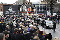 © Licensed to London News Pictures. 01/02/2017. Watford, UK. The coffin of former England football team manager Graham Taylor leaves St Mary's Church after his funeral in Watford, Hertfordshire. The former England, Watford and Aston Villa manager,  who later went on to be chairman of Watford Football Club, died at the age of 72 from a suspected heart attack. Photo credit: Peter Macdiarmid/LNP
