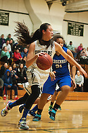 Winooski's Niki Dang (20) drives to the hoop during the girls basketball game between Vergennes and Winooski at Winooski High School on Wednesday night December 9, 2015 in Winooski. (BRIAN JENKINS/for the FREE PRESS)