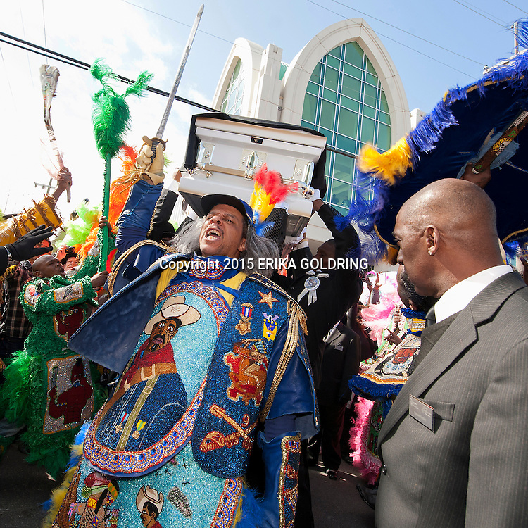 Advocate photo by ERIKA GOLDRING Pallbearers lift the casket three times before putting it in the hearse at the funeral for Bo Dollis, Big Chief of the Wild Magnolias, on Saturday, January 31, 2015, at Xavier Convocation Center in New Orleans.