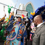 Advocate photo by ERIKA GOLDRING Mardi Gras Indian pallbearers lift the casket three times before putting it in the hearse at the funeral for Bo Dollis, Big Chief of the Wild Magnolias, on Saturday, January 31, 2015, at Xavier Convocation Center in New Orleans.